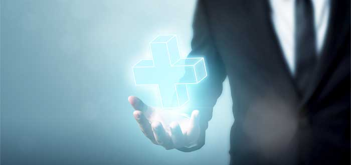 simbolo positivo sobre mano de ejecutivo