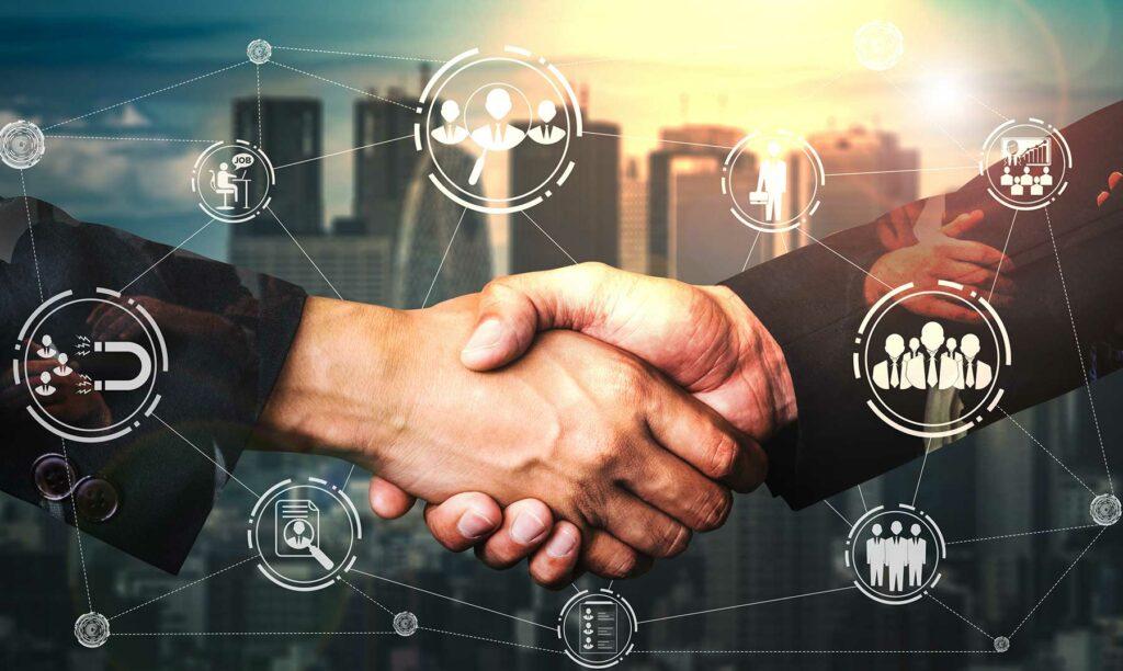 dos manos estrechándose - beneficios del networking
