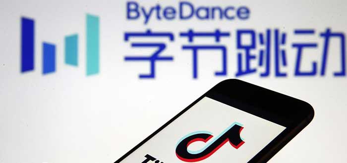 Logo de la empresa unicornio bytedance junto a un móvil con logo de tiktok